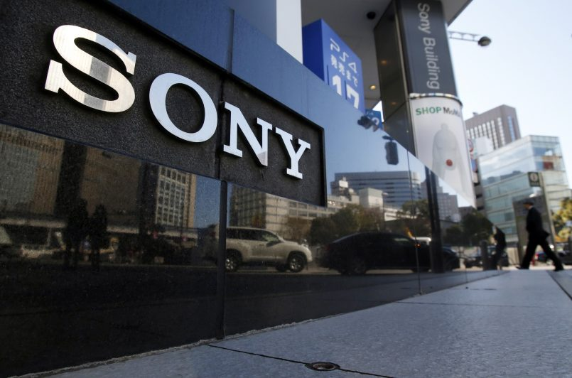 A logo of Sony Corp is seen outside its showroom in Tokyo February 5, 2014. Japanese electronics maker Sony Corp warned it expects a net loss of 110 billion yen ($1.1 billion) this fiscal year as it absorbs restructuring costs linked to its moves to exit the personal computer business. Picture taken February 5, 2014. REUTERS/Yuya Shino (JAPAN - Tags: BUSINESS LOGO) - RTX18A18